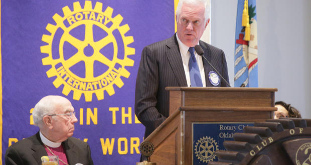 Roy Williams, at lectern, president of the Greater Oklahoma City Chamber, addresses the Oklahoma City Rotary Club 29 on Tuesday about the U.S. Department of Justice's decision to hold off on action regarding the Oklahoma County Jail.