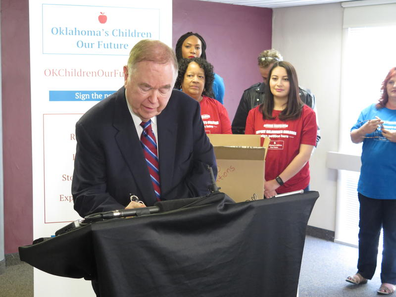 University of Oklahoma president David Boren signs a petition February 16, 2016 for a one cent sales tax proposal to fund education.