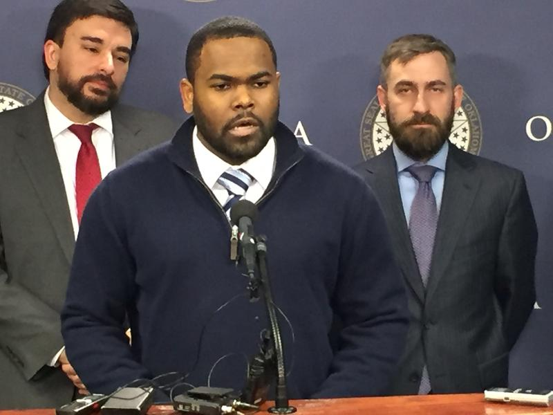 Raja'ee Fatihah, center, addresses the media on Feb. 17, 2016 at the Oklahoma  state capitol with the ACLU's Brady Henderson and Ryan Kiesel.