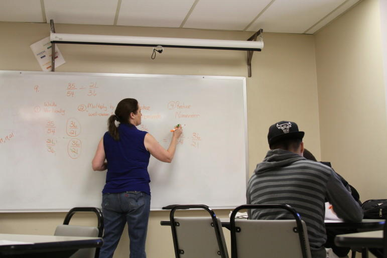 Anne Fisher leads a remedial math study session at Tulsa Community College as students prepare for a final exam last December. TCC is among several universities and colleges in Oklahoma revamping remedial courses in math and English.