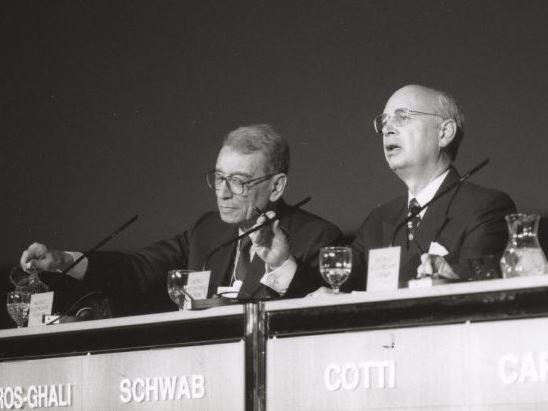 Boutros Boutros-Ghali (left), Secretary-General of the United Nations, and Klaus Schwab (middle), founder and president of the World Economic Forum, and Flavio Cotti, member of the Swiss Federal Council, at the 1995 World Economic Forum.
