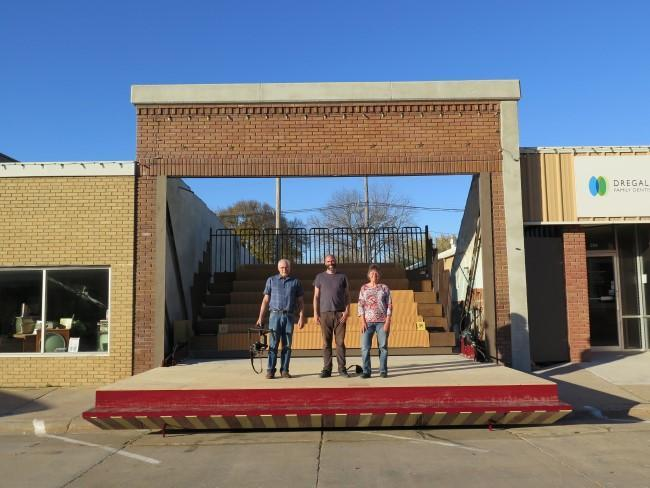Filmmaker Bill Hedges (left), conceptual artist Matthew Mazzotta and community advisor Marilyn Tenney stand on a transformed storefront.