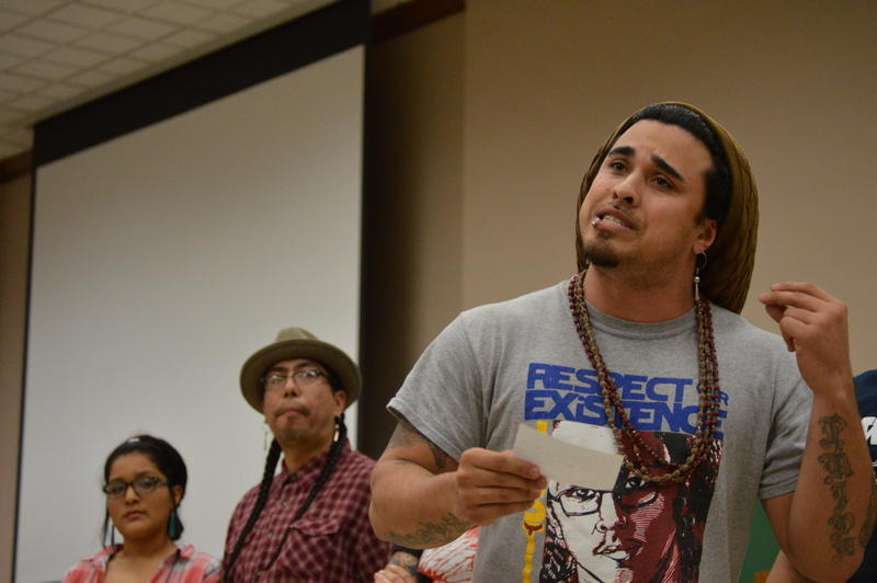 Jesse Robbins speaks in front of students at a town hall forum on race and diversity at the University of Oklahoma.