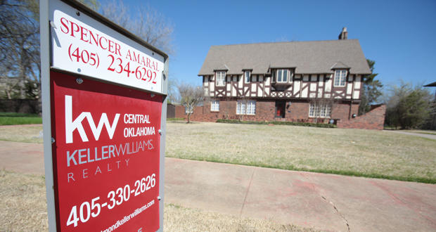 """A """"for sale"""" sign is displayed in front of a house at 707 NE 21st St. in Oklahoma City."""