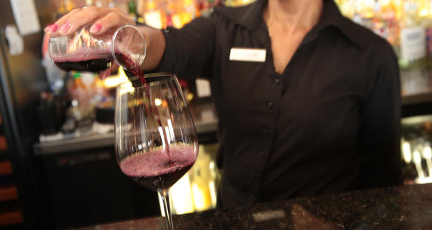 A bartender pours a glass of wine at Cafe 501 in Edmond.