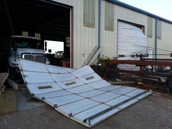 Damage at Johnson Construction in Davis, Okla. Wednesday morning. The business lost three overhead doors.