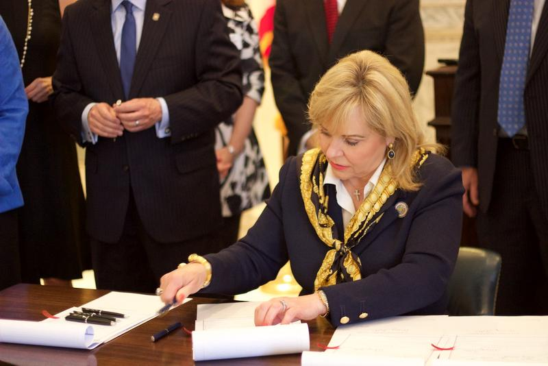 Gov. Mary Fallin signs into law bills part of a criminal justice reform package