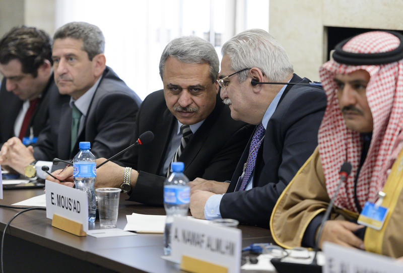 Syrian interior opposition member Mahmoud Marai, third right, listens to Elian Mous'ad, second right, during a meeting with the UN Syria Envoy during Syria peace talks at the United Nations Office in Geneva, Switzerland.
