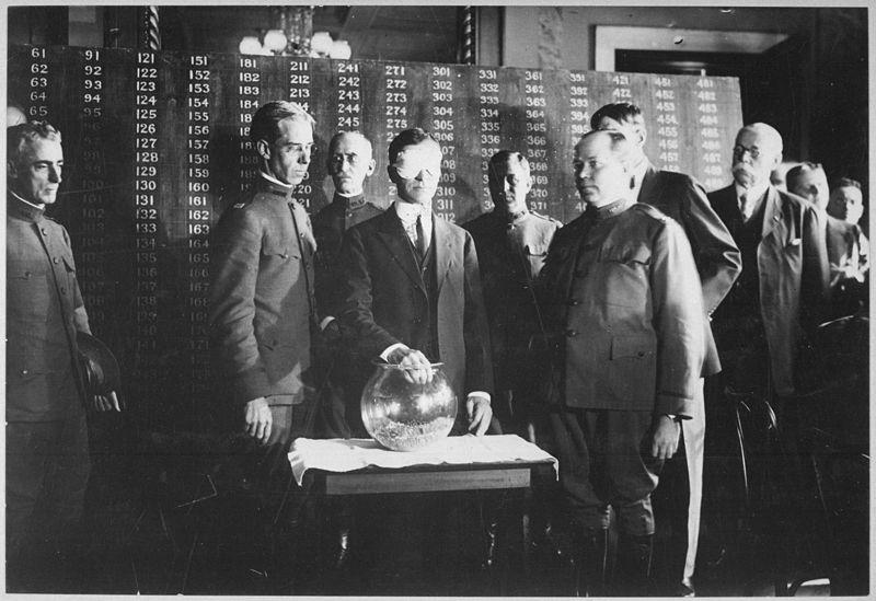 United States Secretary of War Newton Baker pulls the first draft number on July 20, 1917