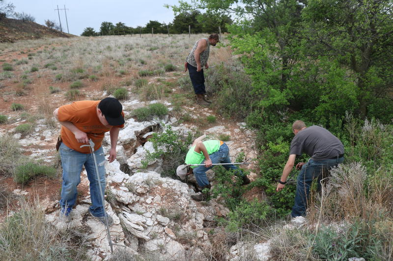 Jon Struve, David Wilson, Ty Judd and Max Geiser inspect a rattlesnake den near Okeene, Oklahoma on April 16, 2016.