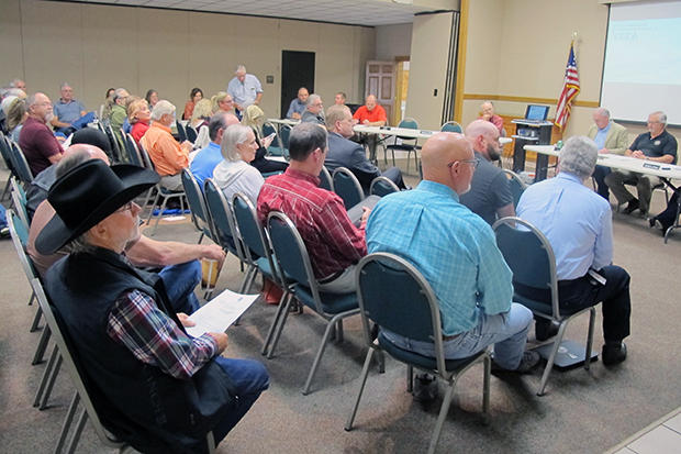 The Oklahoma Scenic Rivers Commission and audience members listen to a presentation on right-to-farm at the April 19 meeting in Tahlequah, Okla.