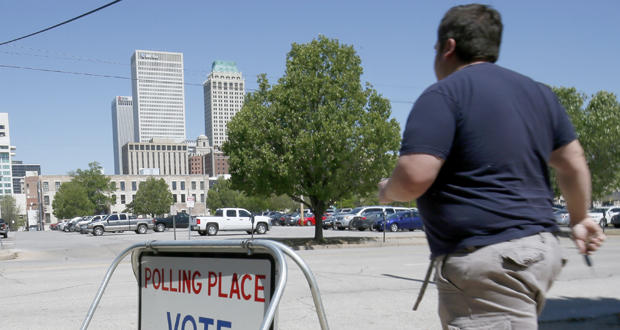 Tulsa resident Ashley Hacker exits a polling place after casting his vote on a sales tax extension proposal Tuesday.