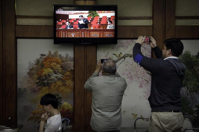 Restaurant diners watch a broadcast of the 7th Congress of the Workers' Party of Korea on local television, where North Korean leader Kim Jong Un is seen delivering a speech on Friday, May 6, 2016, in Pyongyang, North Korea.