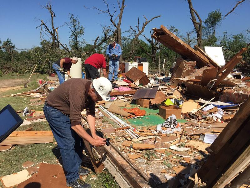Tim Marshall assists National Weather Service survey teams southeast of Wynnewood, just east of Interstate 35.
