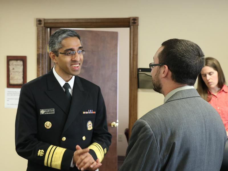 U.S. Surgeon General Vivek Murthy talks with recovering addict Justin Zagaruyka on Monday at Catalyst Behavioral Services in Oklahoma City.