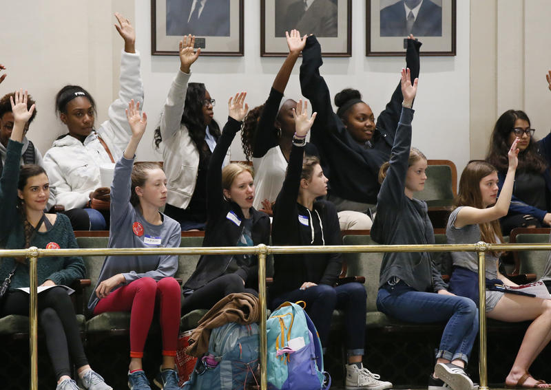 Students from Classen School of Advanced Studies, an Oklahoma City high school, wave as they are recognized in the gallery of the Oklahoma House in Oklahoma City, Wednesday, May 18, 2016. The students were at the state Capitol to protest budget cuts.