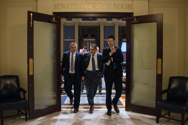 State Sens. Greg Treat, R-Oklahoma City (left), Clark Jolley, R-Edmond, (center), and David Holt, R-Oklahoma City (right) emerge from Tuesday morning's budget meeting at the state Capitol.