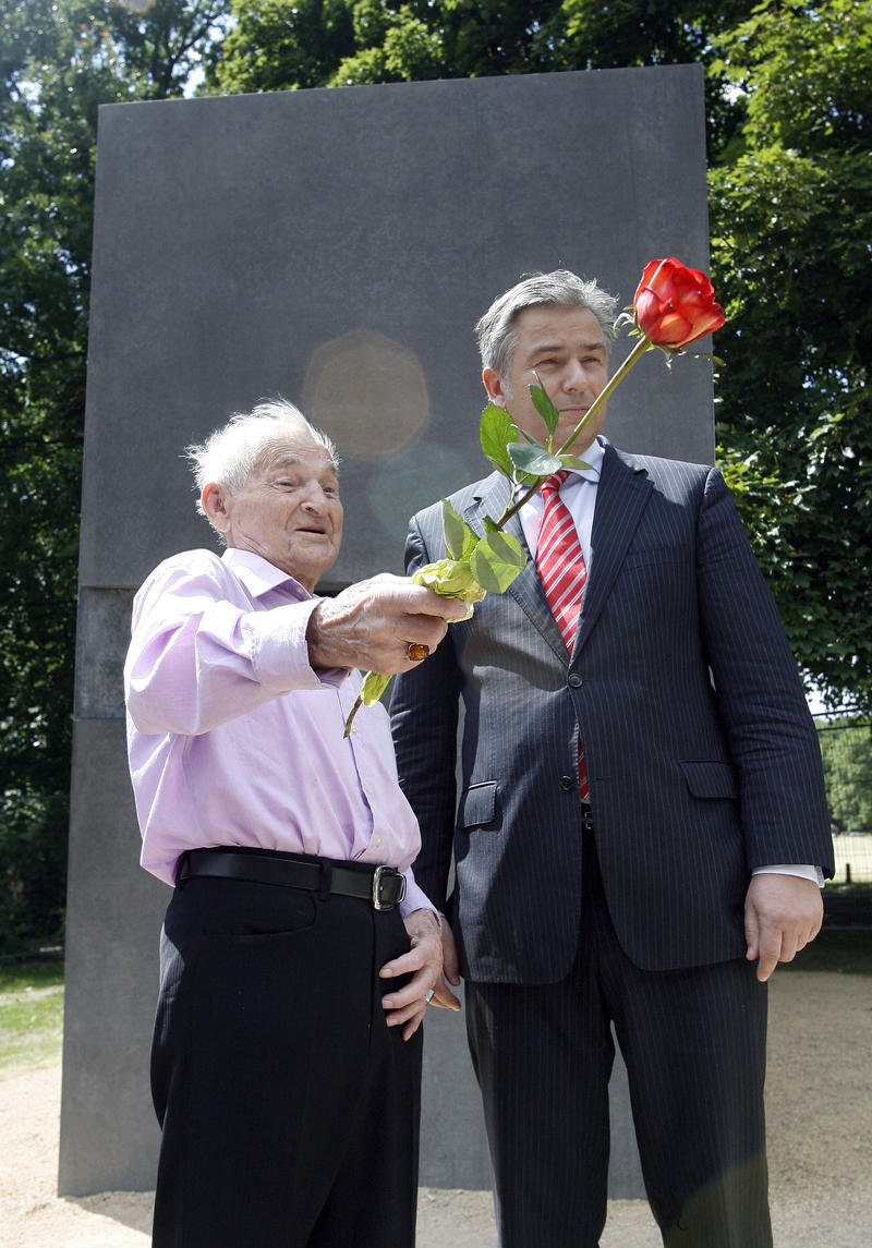 The Mayor of Berlin, Klaus Wowereit, right, and Holocaust survivor Rudolf Brazda, left, talk in front of a memorial for homosexual victims persecuted by the Nazi regime in Berlin, Germany, Friday, June 27, 2008.