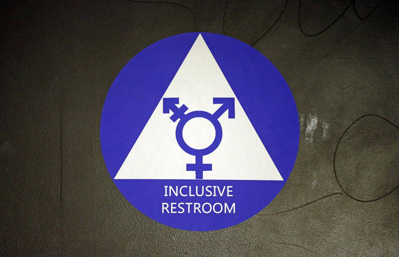 A new sticker designates a gender neutral bathroom at Nathan Hale high school Tuesday, May 17, 2016, in Seattle.