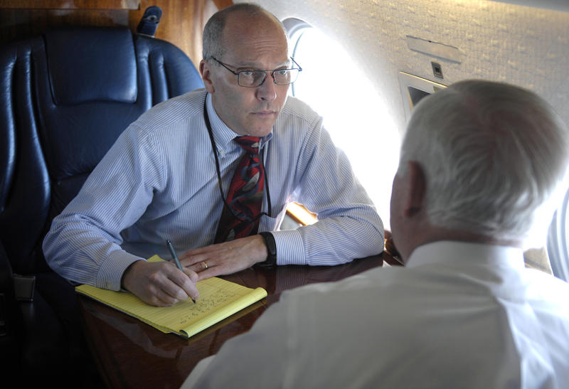The New York Times' Pentagon correspondent Thom Shanker interviews Defense Secretary Robert Gates aboard an aircraft headed for West Point, New York, April 21, 2008.