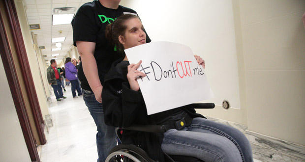 Jordan Martin and other developmentally disabled people, along with advocates and caregivers, urged lawmakers to prevent budget cuts at the state Capitol in Oklahoma City Thursday.