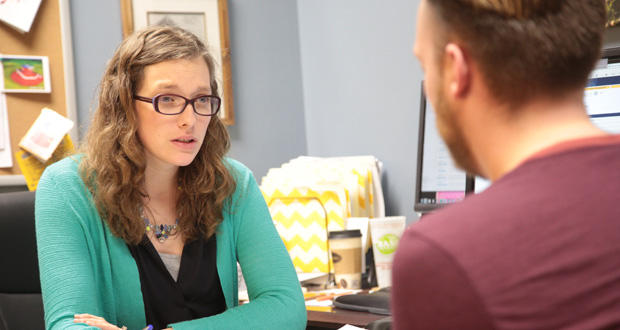 Counselor Hannah Leftwich speaks with a student at the University of Central Oklahoma in Edmond. By considering multi-year budget projections, the state could anticipate demographic changes coming for entities like universities.