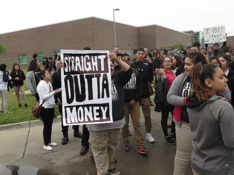 Students protest outside U.S. Grant High School in Oklahoma City Monday morning.