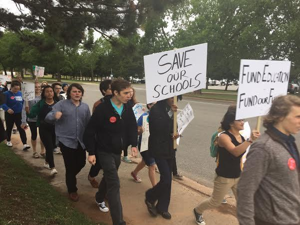 Students from the Classen School of Advanced Studies march from their school to the Capitol on May 18, 2016 in protest of state budget cuts.