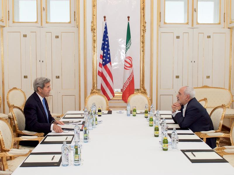 U.S. Secretary of State John Kerry and Iran's foreign minister Mohammad Javad Zarif meet in the  Palais Coburg Blue Salon on July 1, 2015 during nuclear deal negotiations.
