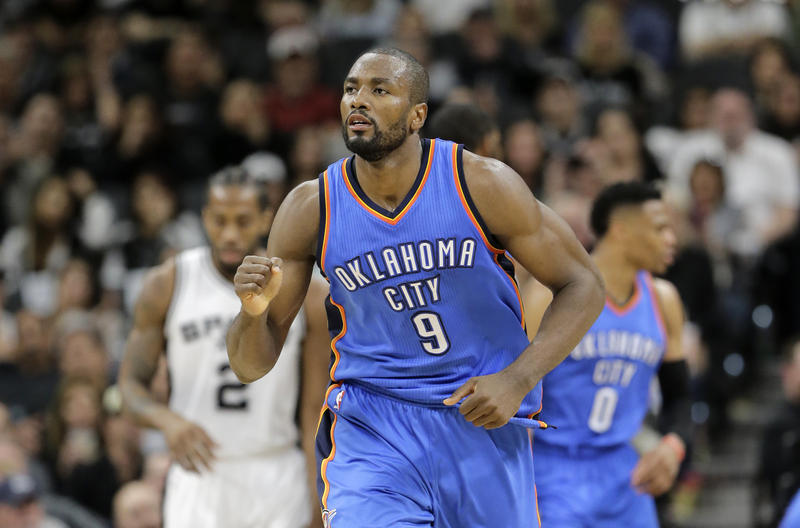 The Oklahoma City Thunder's Serge Ibaka celebrates a basket against the San Antonio Spurs during the second half in Game 2 of a second-round NBA basketball playoff series, Monday, May 2, 2016, in San Antonio.