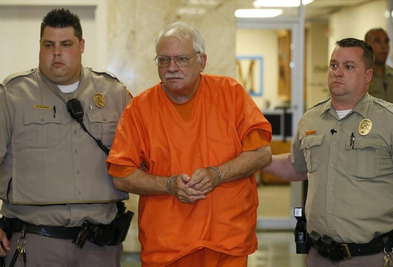 Robert Bates, a former Oklahoma volunteer sheriff's deputy who said he mistook his handgun for his stun gun when he fatally shot an unarmed suspect last year, is escorted from the courtroom following his sentencing at the courthouse in Tulsa, May 31, 2016