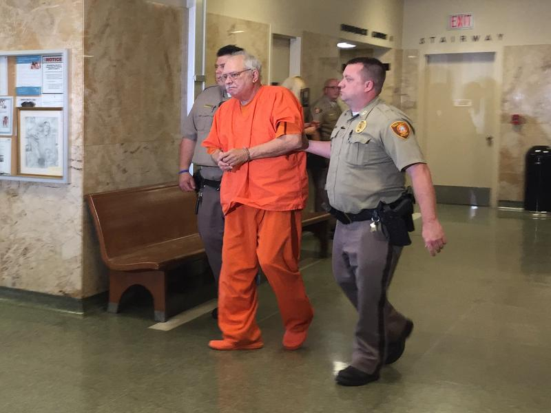 Tulsa County Sheriff's deputies lead Robert Bates out of the courtroom Tuesday after he was sentenced to four years in prison, May 31, 2016.