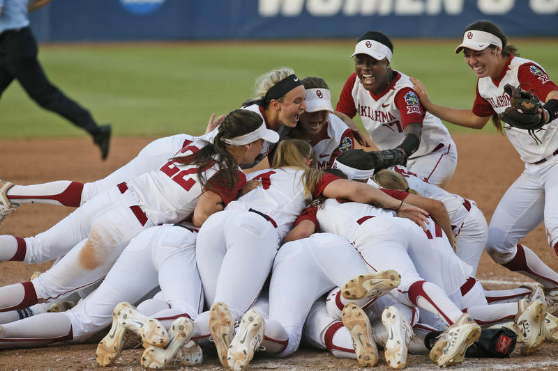 University of players celebrate after defeating Auburn 2-1 in the deciding game of the championship series of the NCAA softball College World Series, Wednesday, June 8, 2016, in Oklahoma City.