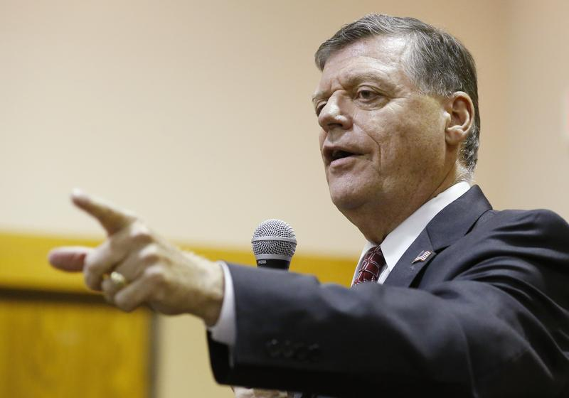 U.S. Rep. Tom Cole, R-Oklahoma, gestures as he speaks during a Town Hall meeting in Moore, Okla., Tuesday, Aug. 18, 2015.
