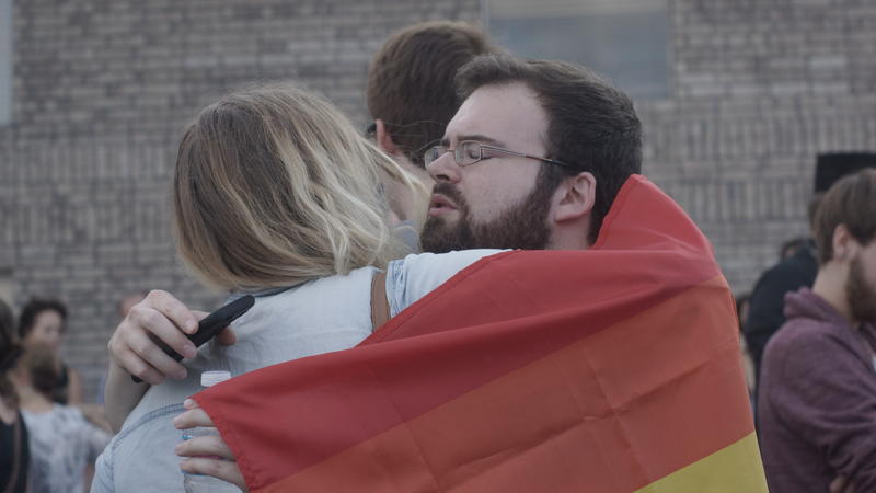 Rally goers greeted each other with hugs at the Freedom Oklahoma offices in Oklahoma City on June 12, 2016.