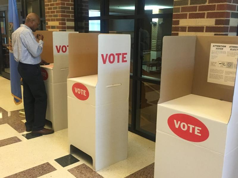 Rodney Redus of Oklahoma City votes at the Oklahoma School of Science and Mathematics polling location in Tuesday's primary. Only 47 voters had cast their ballots at the site as of 2:30 p.m.