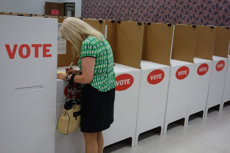 Edmond resident Jay Mandraccia casts her primary ballot during early voting Thursday at the Oklahoma County Board of Elections. Regular voting will be held Tuesday.