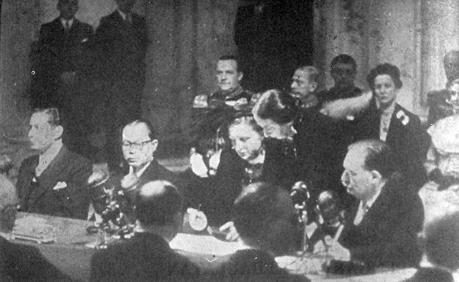 The Dutch Queen Juliana signs the document transferring sovereignty to the United States of Indonesia in The Hague,December 27, 1949.