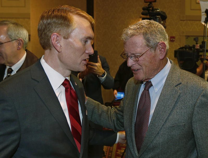 U.S. Sen. James Lankford, R-Okla., talks with Sen. Jim Inhofe, R-Okla. on Nov. 4, 2014 shortly after his election to the U.S. Senate