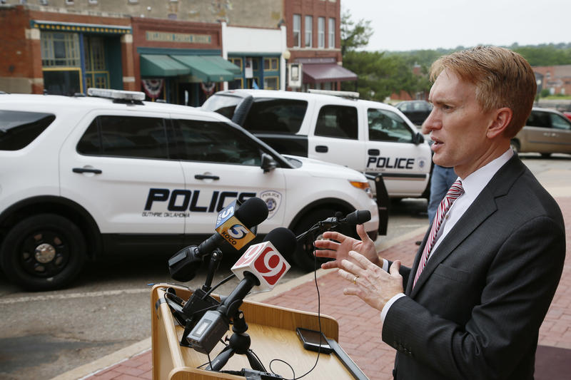 U.S. Sen. James Lankford, R-Oklahoma, talks with the media outside police headquarters in Guthrie, Okla, Friday, July 8, 2016. Lankford visited with police officers during a private meeting.