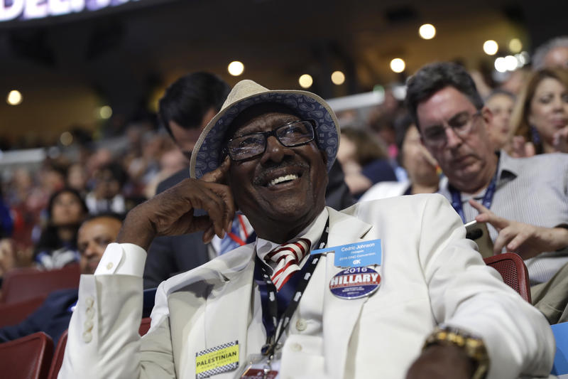 Oklahoma delegate Cedric Johnson smiles as he watches during the second day session of the Democratic National Convention in Philadelphia, Tuesday, July 26, 2016.