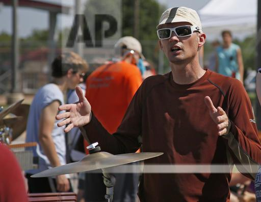 Kevin McDonald, Edmond Memorial High School English teacher, directs the percussion session of the band during a practice in Edmond, Okla., on Thursday.