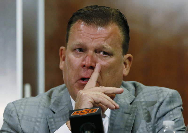 Oklahoma State basketball coach Brad Underwood fights back tears at a news conference in Stillwater, Okla., Friday, July 22, 2016.