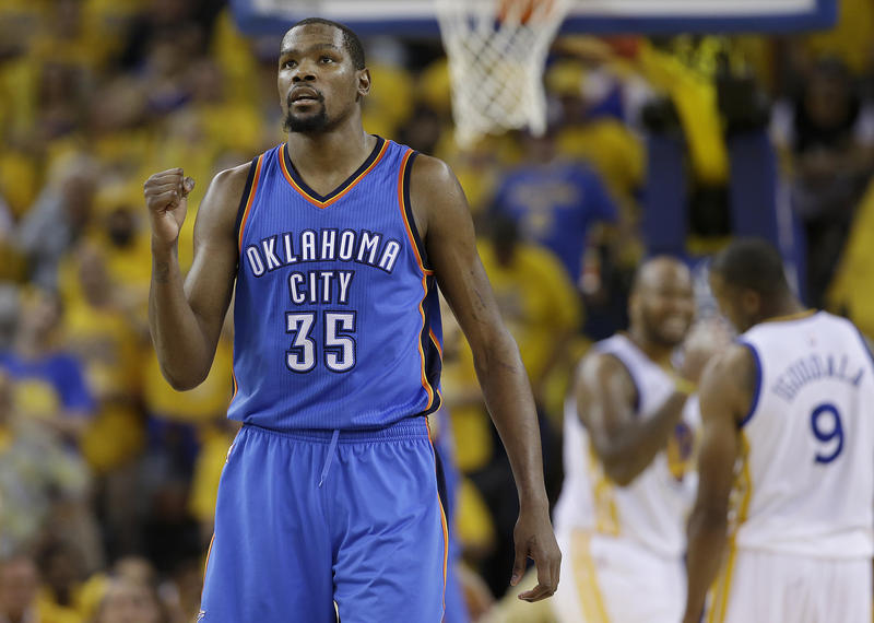 Oklahoma City Thunder forward Kevin Durant (35) reacts during the second half of Game 7 of the NBA basketball Western Conference finals against the Golden State Warriors in Oakland, Calif.