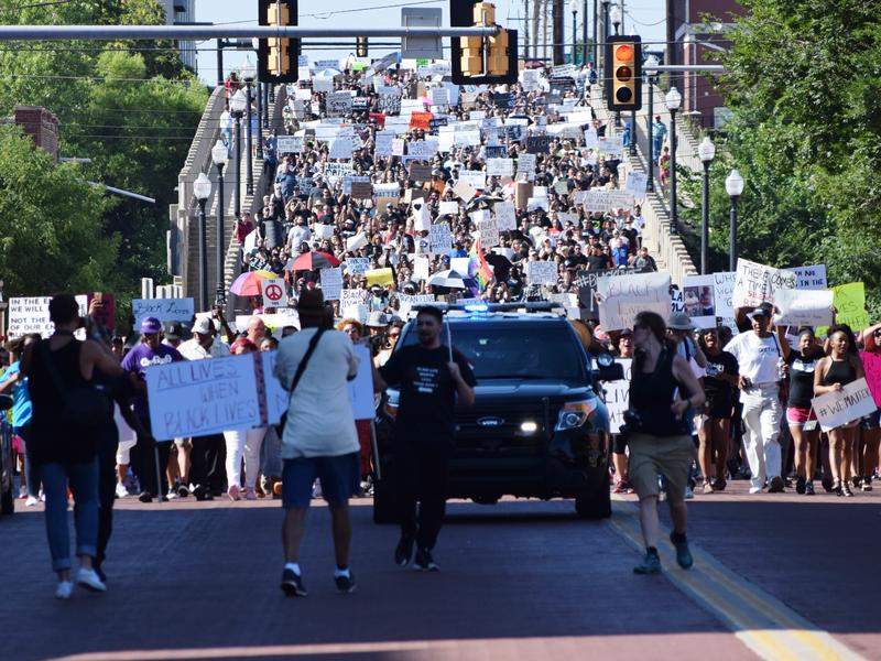 More than 1,000 demonstrators march down the Walnut Ave. bridge in Bricktown during Sunday evening's Black Lives Matter protest.