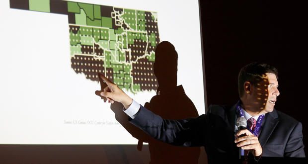 Oklahoma City University professor Kyle Dean presents findings of an economic impact report during the Oklahoma Indian Gaming Association conference Tuesday in Tulsa.