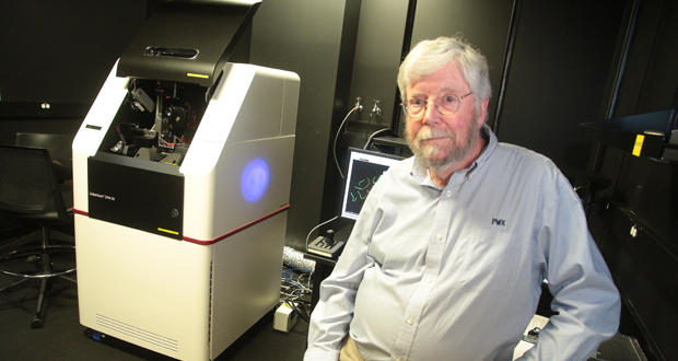 Paul Kincade, research vice president at the Oklahoma Medical Research Foundation, sits next to a new laser microscope in Oklahoma City.
