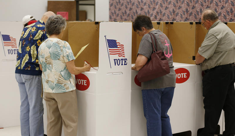 Voters participate in early voting at the Oklahoma County Elections Board in Oklahoma City, Thursday, June 19, 2014.