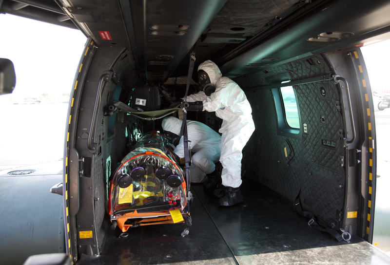 Military medical personnel attend a drill that simulates a biological or nuclear attack at Galeo Air Base in Rio de Janeiro, Brazil, Friday, July 15, 2016.