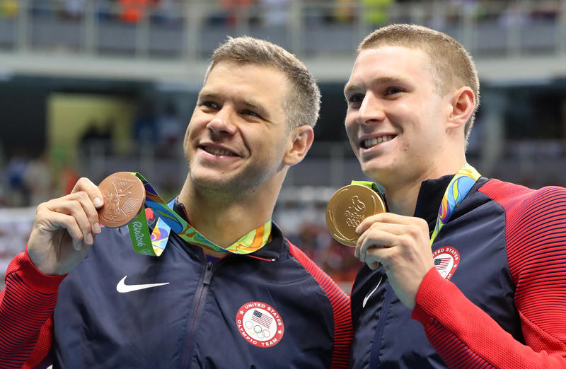 The United States' Ryan Murphy, right, and bronze medalist David Plummer celebrate with their medals after the men's 100-meter backstroke at the swimming competitions at the 2016 Summer Olympics, Monday in Rio de Janeiro, Brazil.